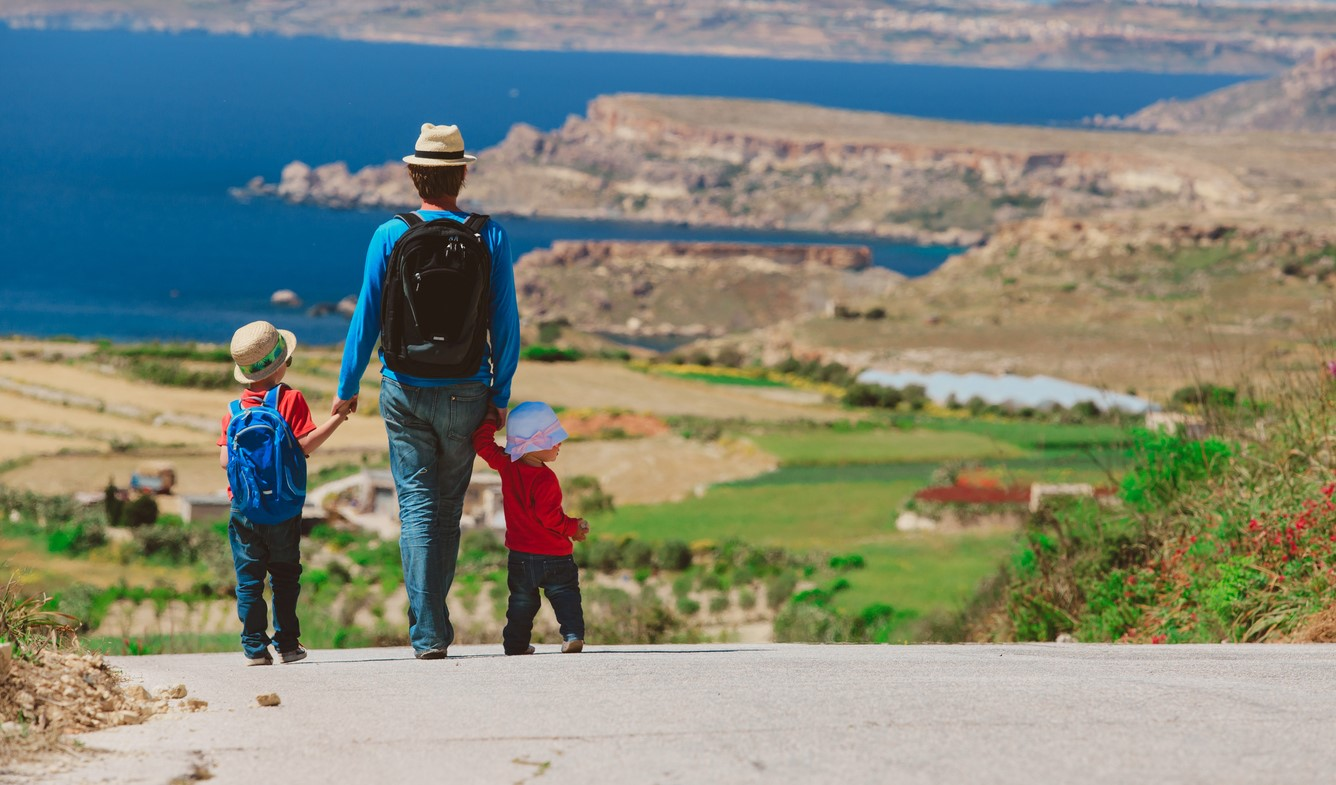 Family with two kids enjoying scenic walk in Malta