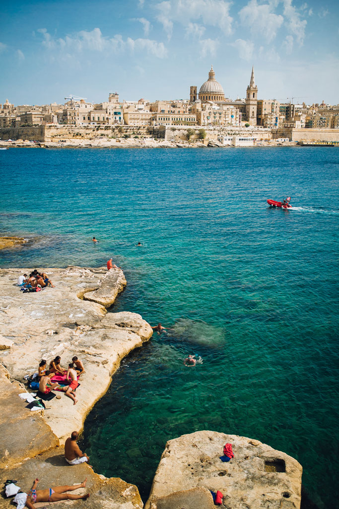 Swimming on the rocky beaches in Sliema